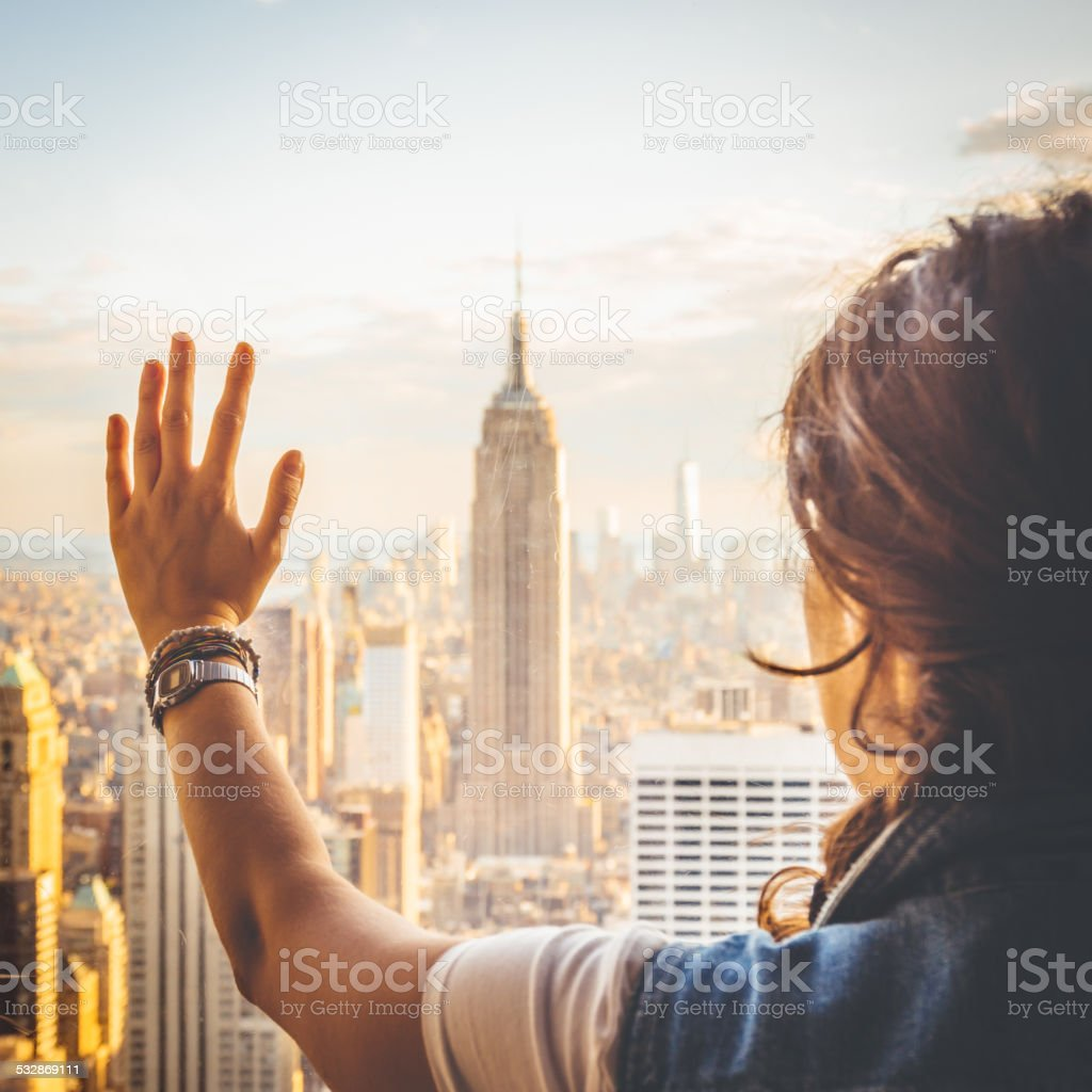Young woman near a window in New York stock photo