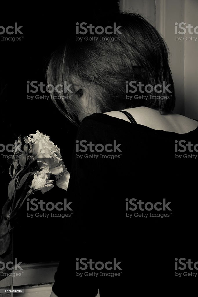 Young woman near a window royalty-free stock photo