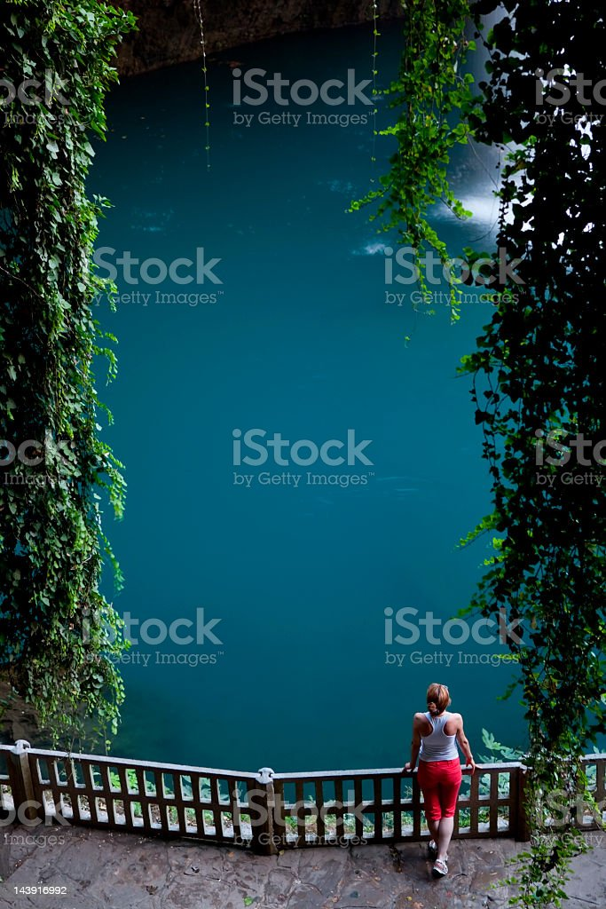 Young Woman near the Waterfall with ivy stock photo
