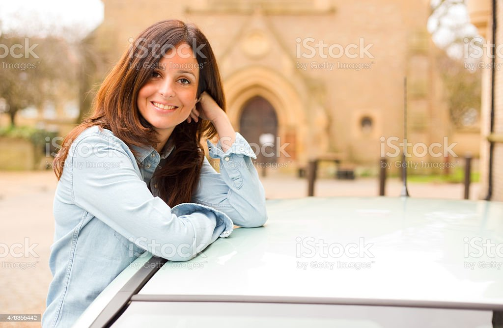 young woman next to her car stock photo