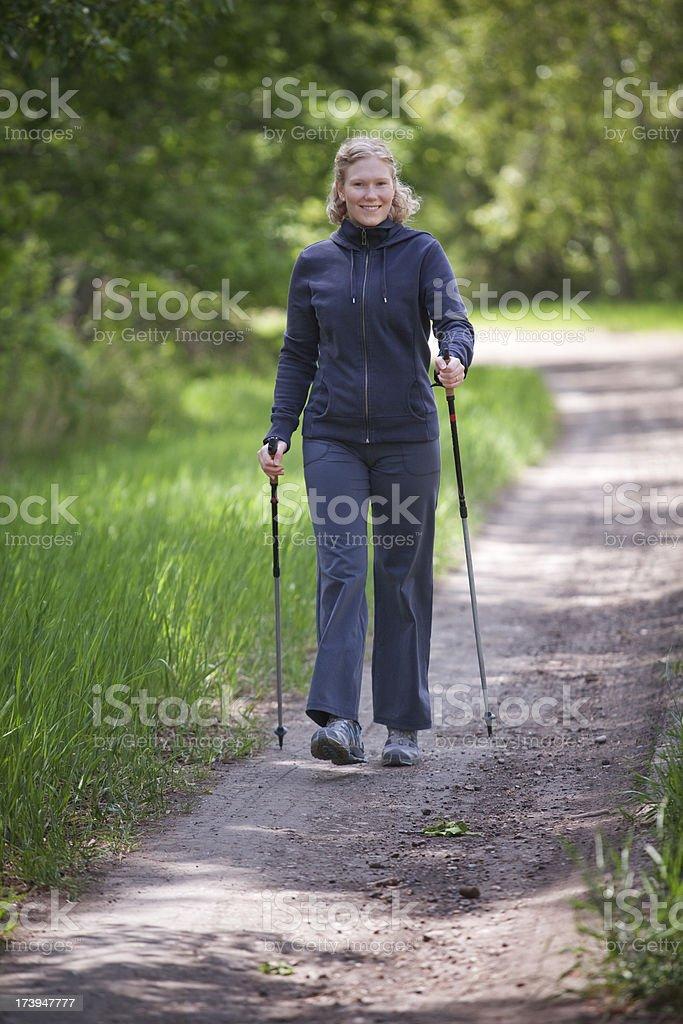Young Woman Nordic Walking royalty-free stock photo