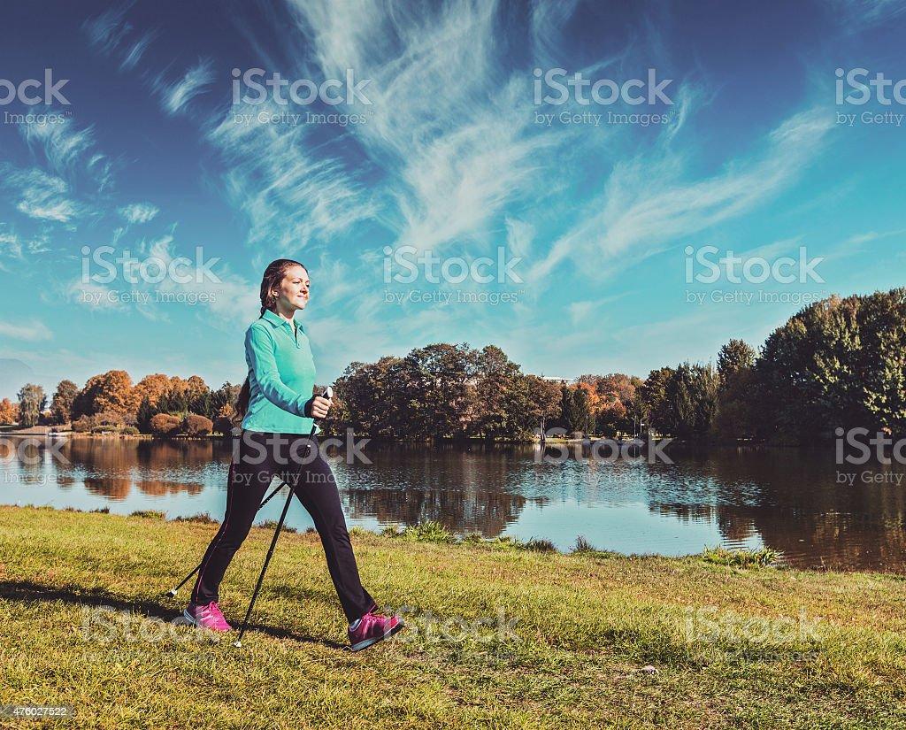 Young woman nordic walking stock photo