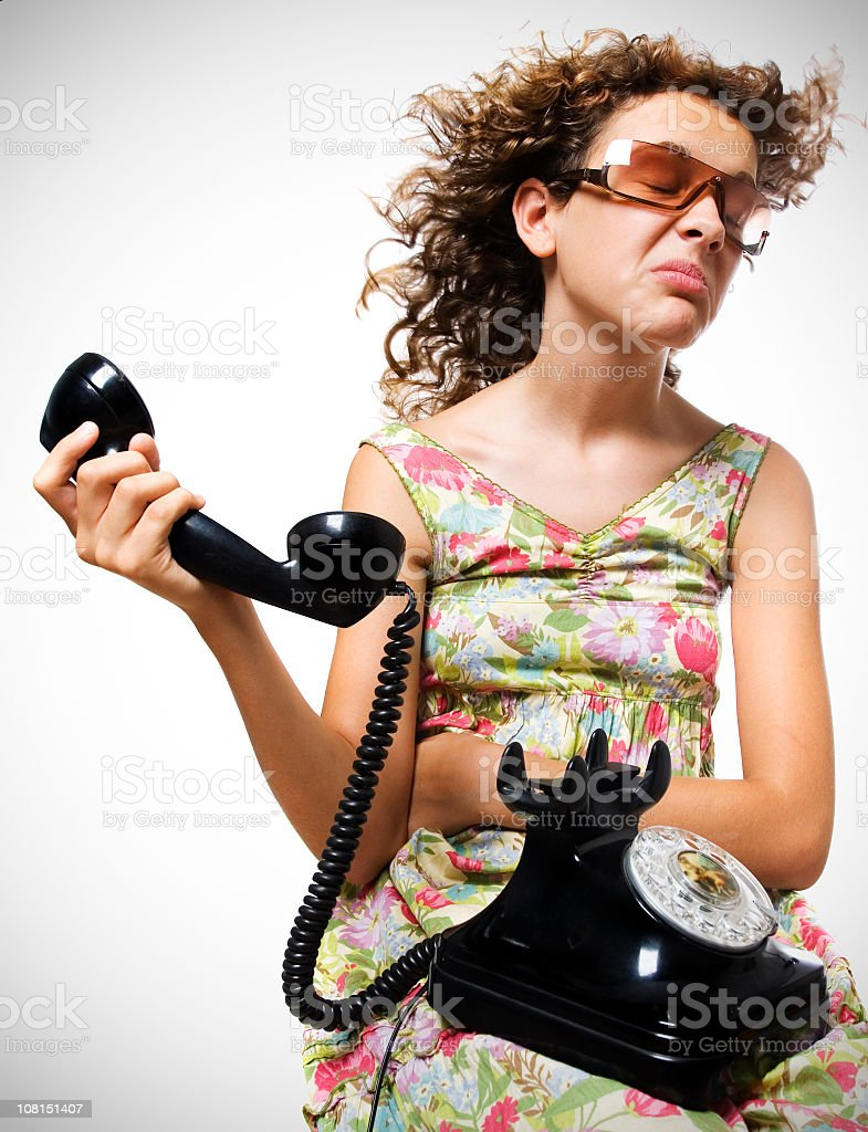 Young Woman Not Listening to Person on Telephone stock photo