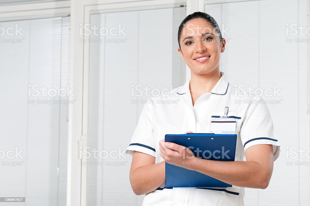 Young woman nurse at hospital stock photo