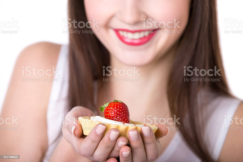 Young woman offering a cake stock photo