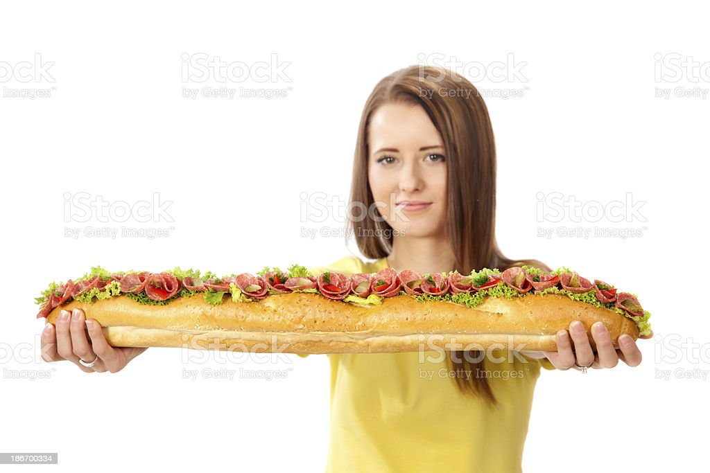 Young woman offering big sandwich. royalty-free stock photo