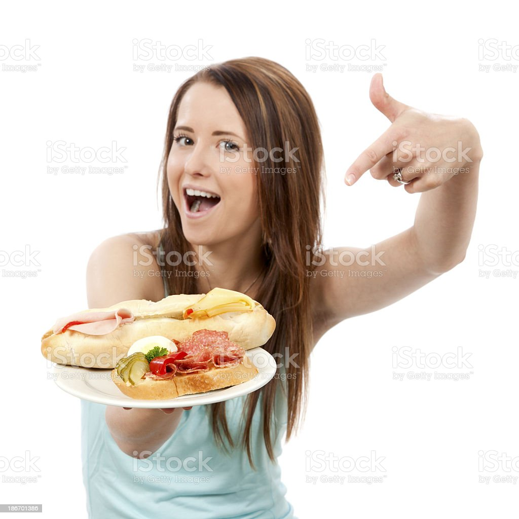 Young woman offering sandwich on a plate. royalty-free stock photo