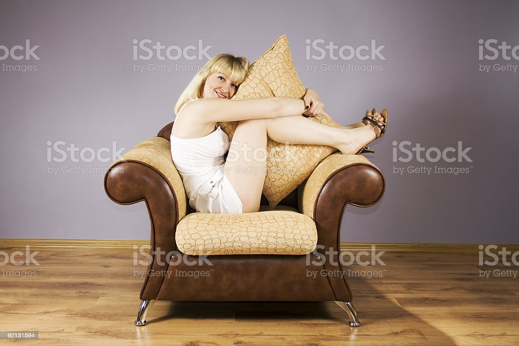 Young Woman on a armchair royalty-free stock photo
