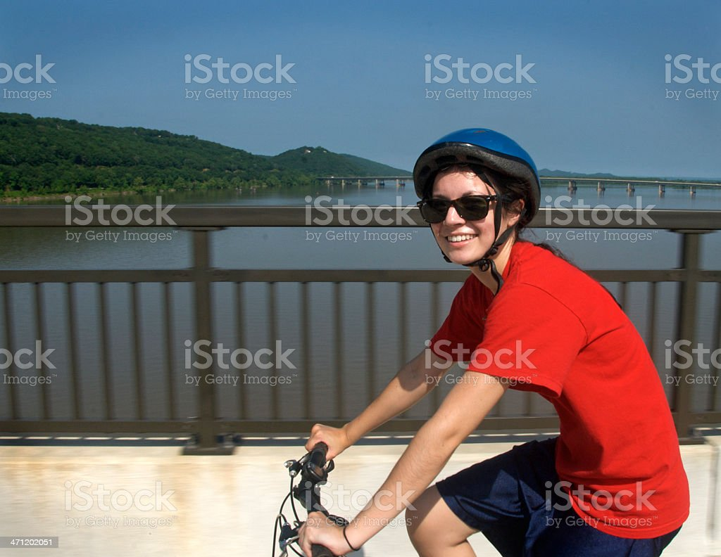Young Woman on a Bicycle stock photo