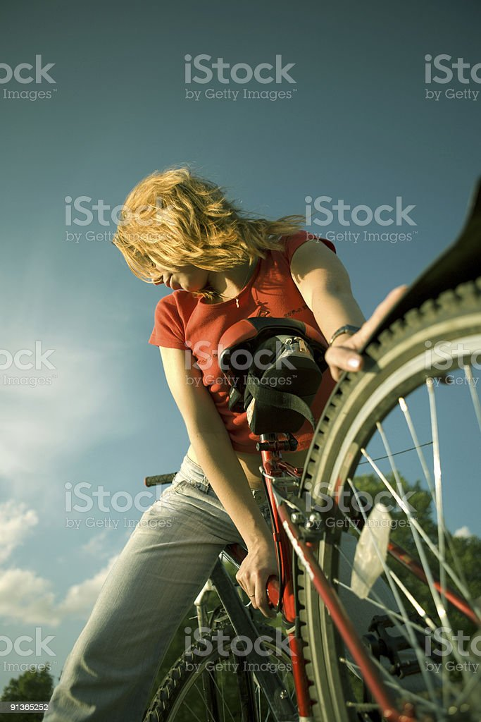 Young woman on a bicycle royalty-free stock photo