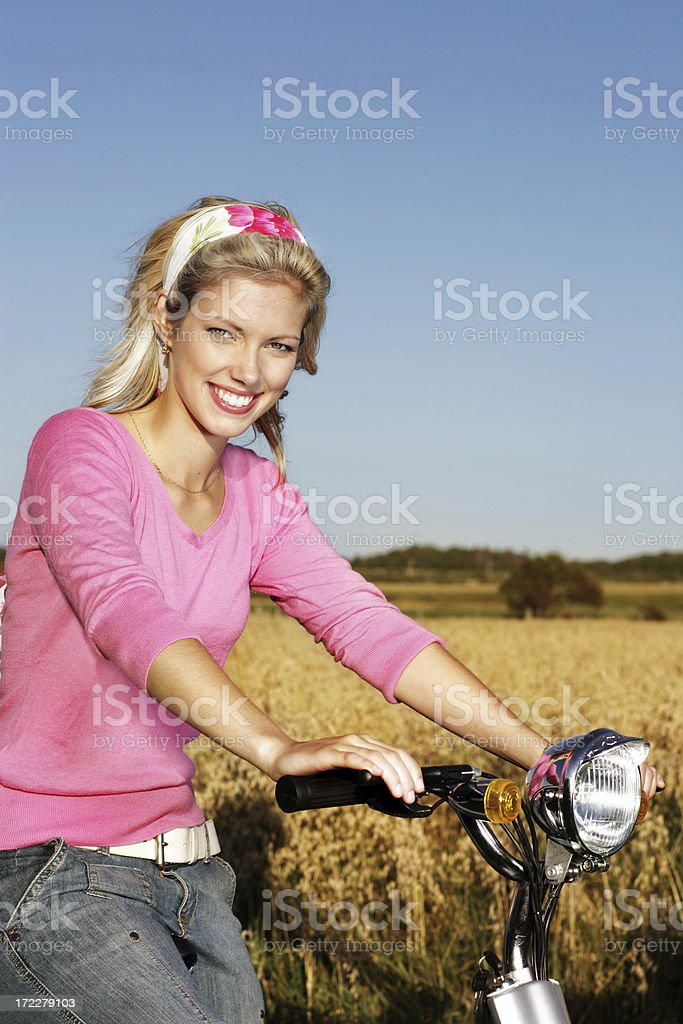 Young woman on a Bike royalty-free stock photo