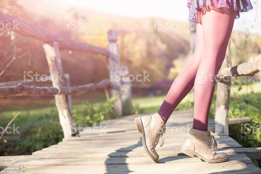 Young woman on a bridge stock photo