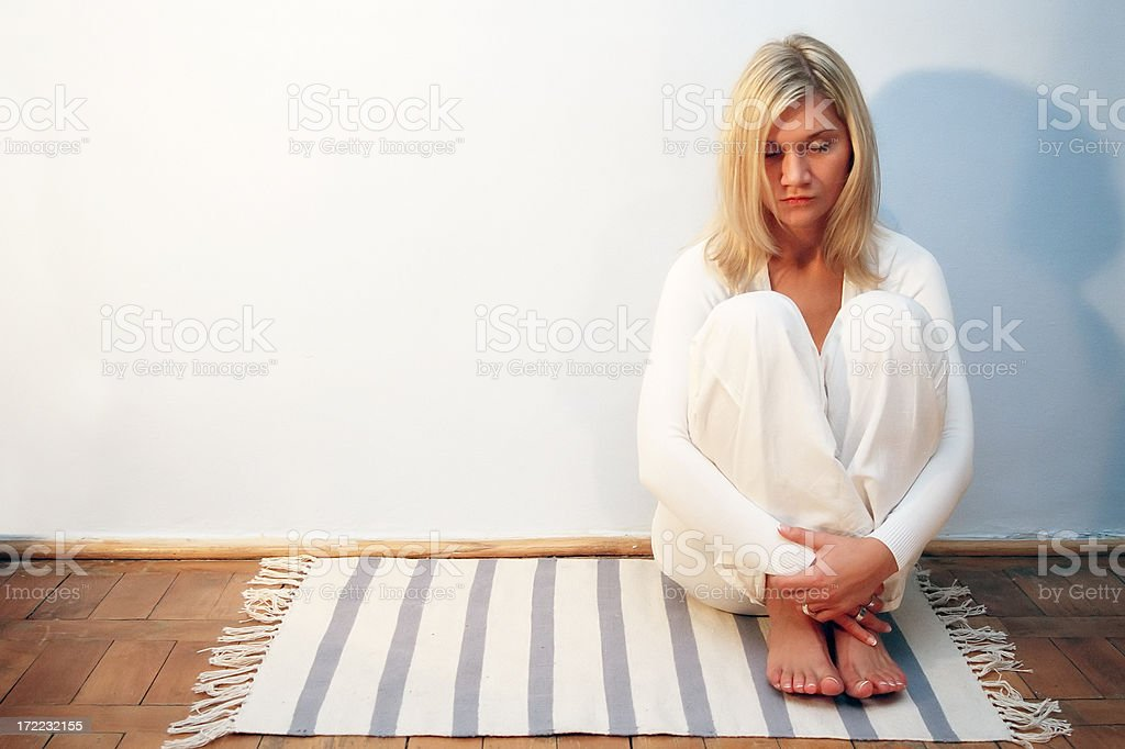 Young woman on a carpet royalty-free stock photo