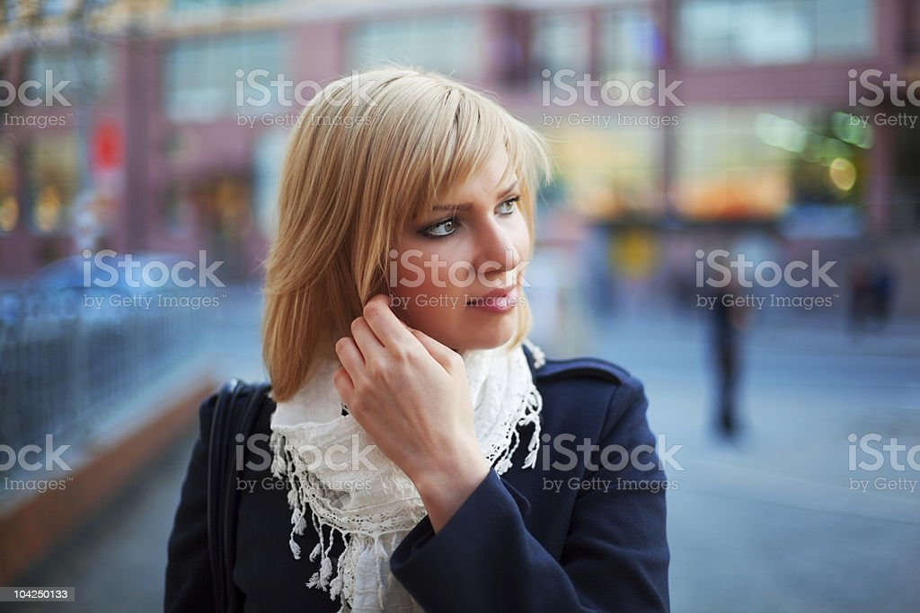 Young woman on a city street royalty-free stock photo