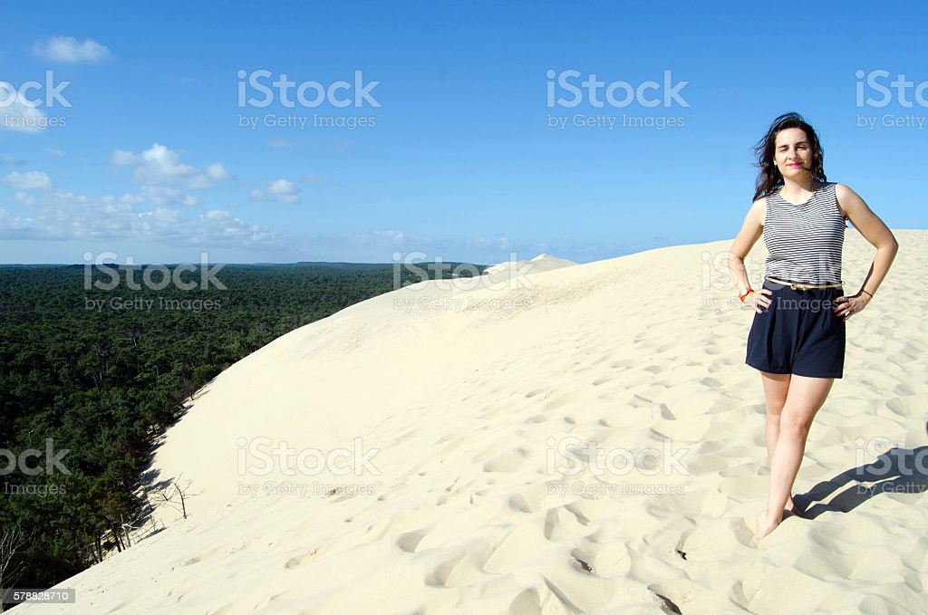 Young woman on a dune stock photo