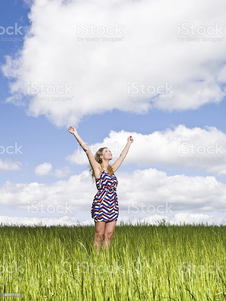 Young woman on a field stock photo