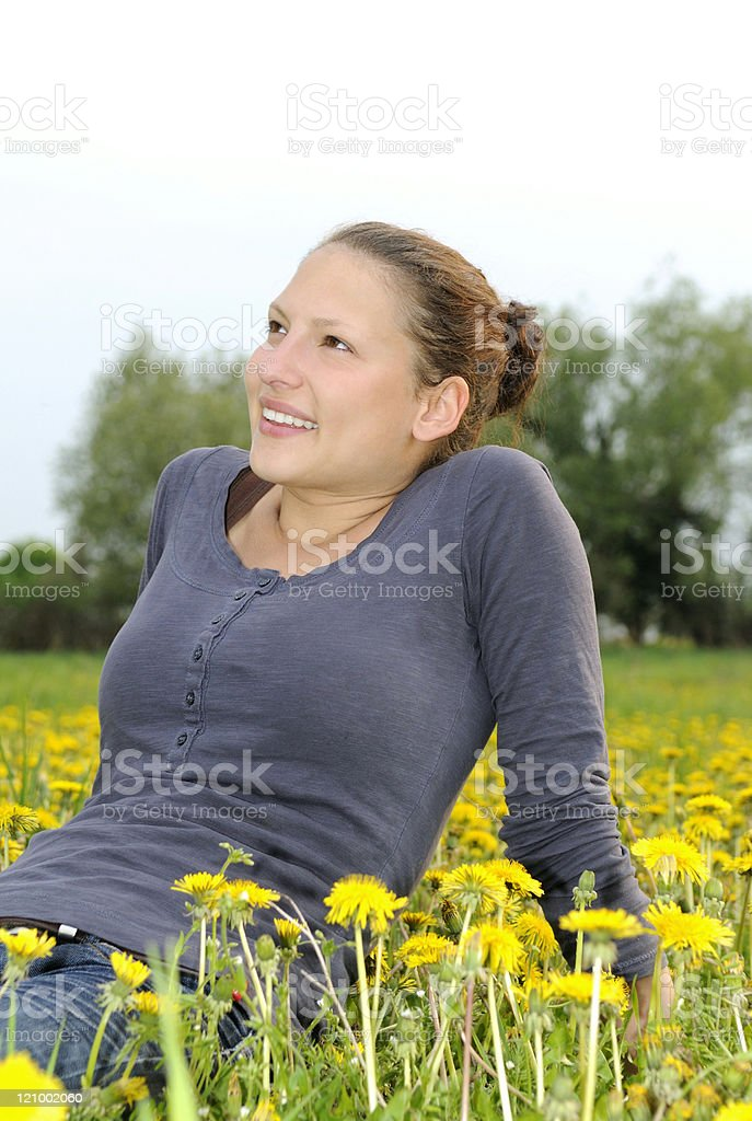 young woman on a flower meadow stock photo