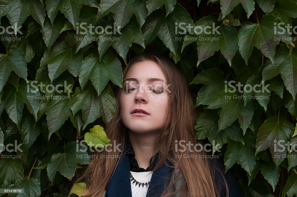 young woman on a green wall background stock photo
