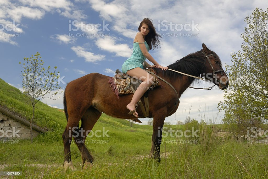 Young woman on a horse royalty-free stock photo