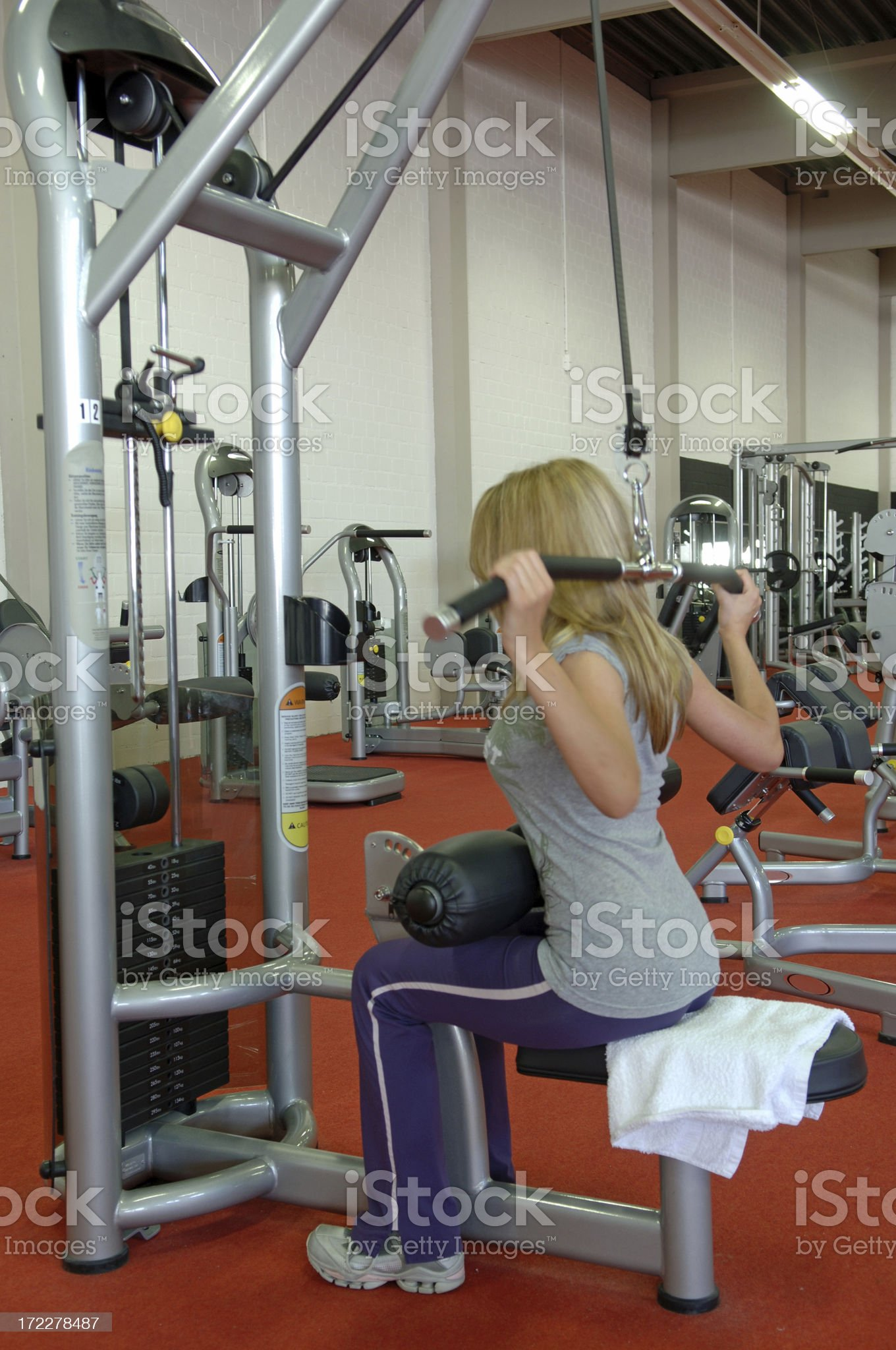 Young woman on a lat machine royalty-free stock photo