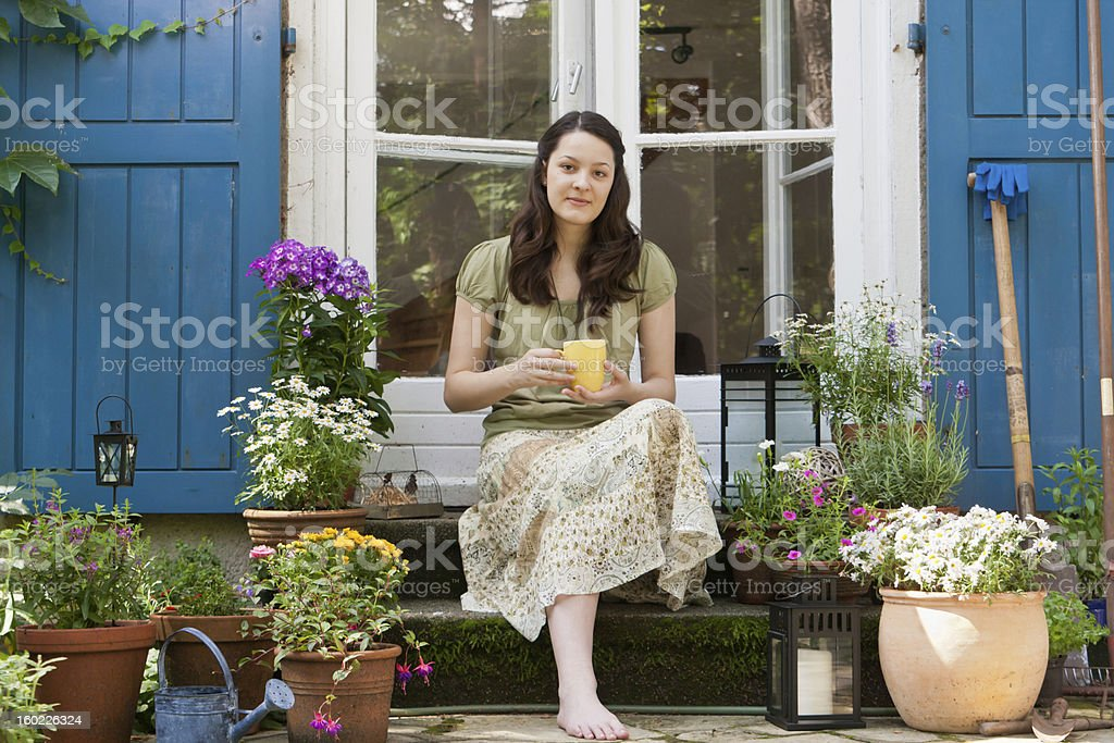 young woman on a patio royalty-free stock photo