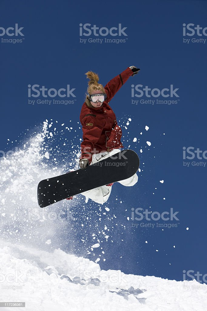 Young Woman On A Snowboard royalty-free stock photo