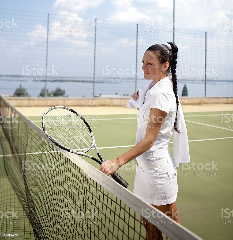Young woman on a tennis court royalty-free stock photo