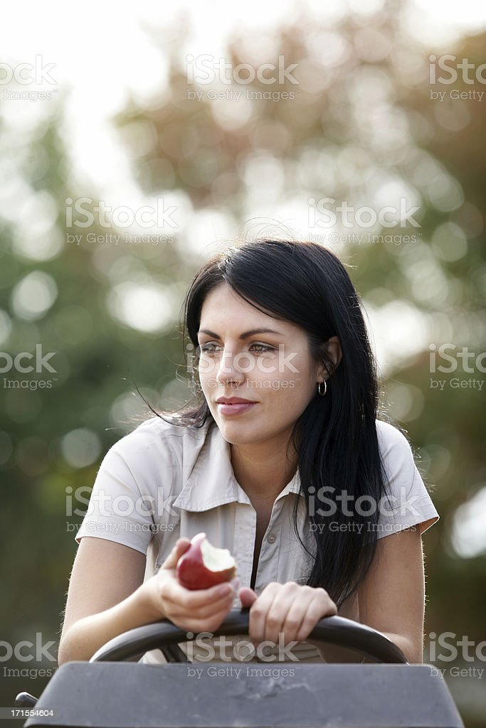 Young woman on a tractor royalty-free stock photo