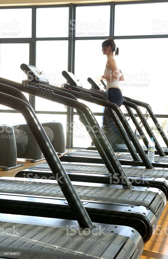 Young woman on a treadmill #2 royalty-free stock photo