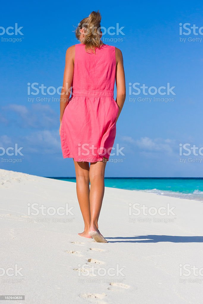 young woman on a tropical beach royalty-free stock photo