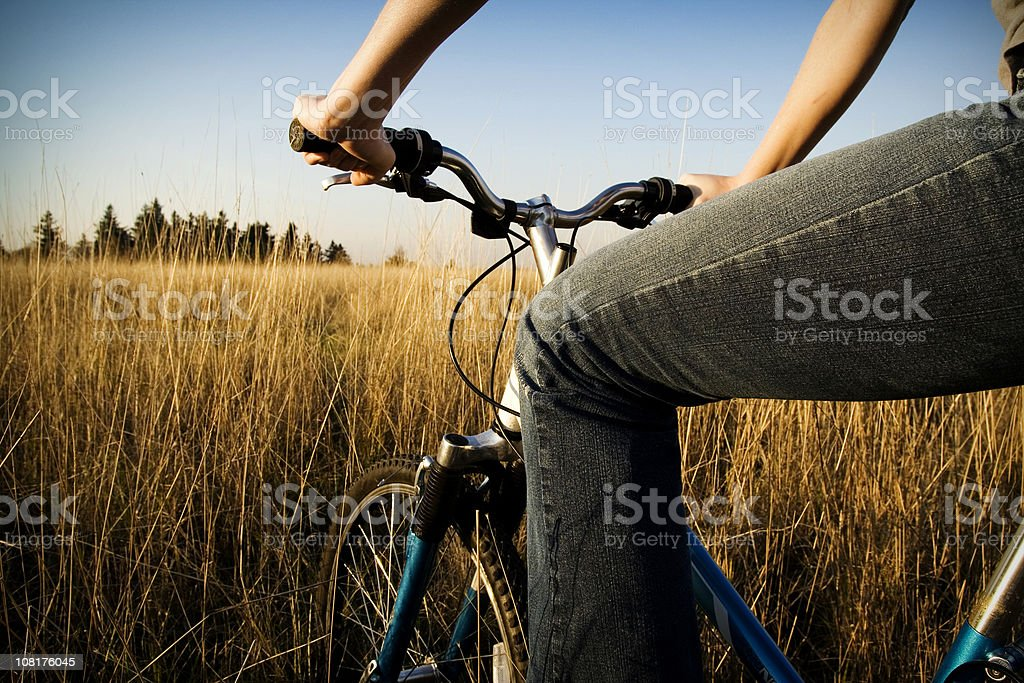 Young Woman on Afternoon Nature Bike Ride royalty-free stock photo