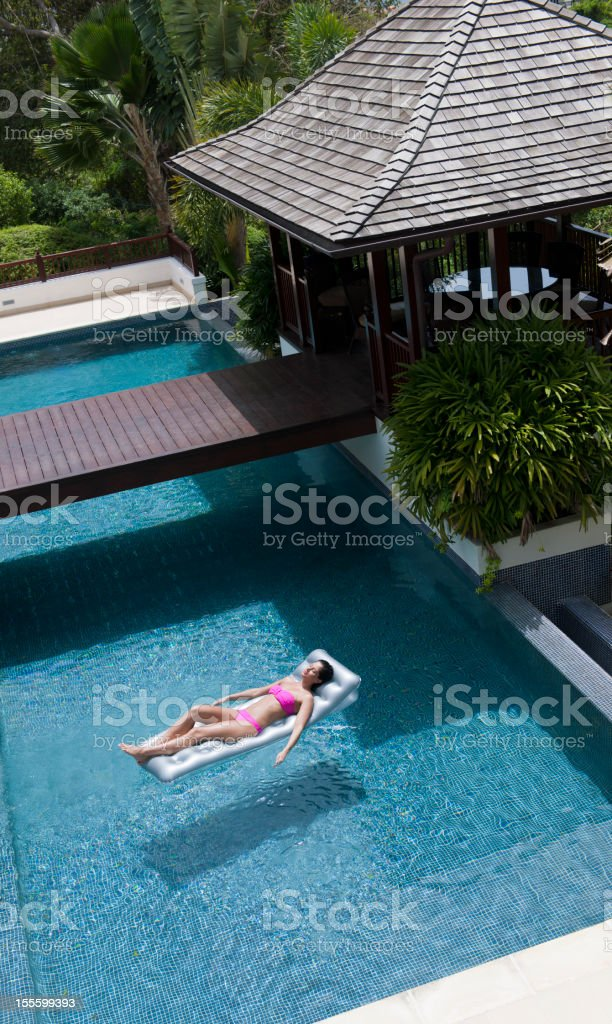 Young woman on air bed royalty-free stock photo