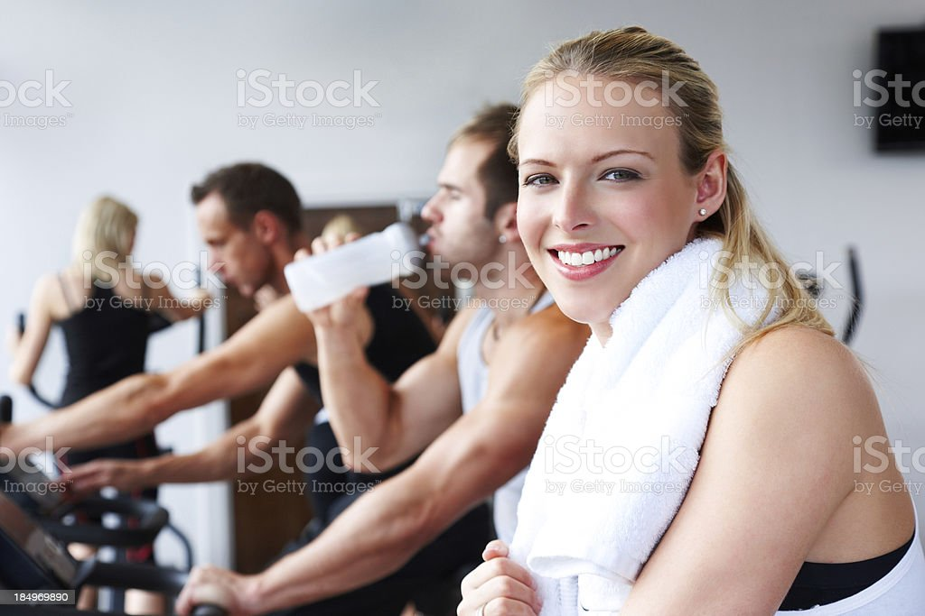 Young Woman on an Exercise Bike royalty-free stock photo