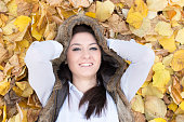 Young woman on autumn leaves.