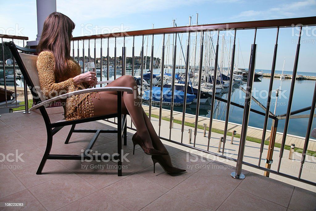 Young woman on balcony-Novigrad-Croatia royalty-free stock photo