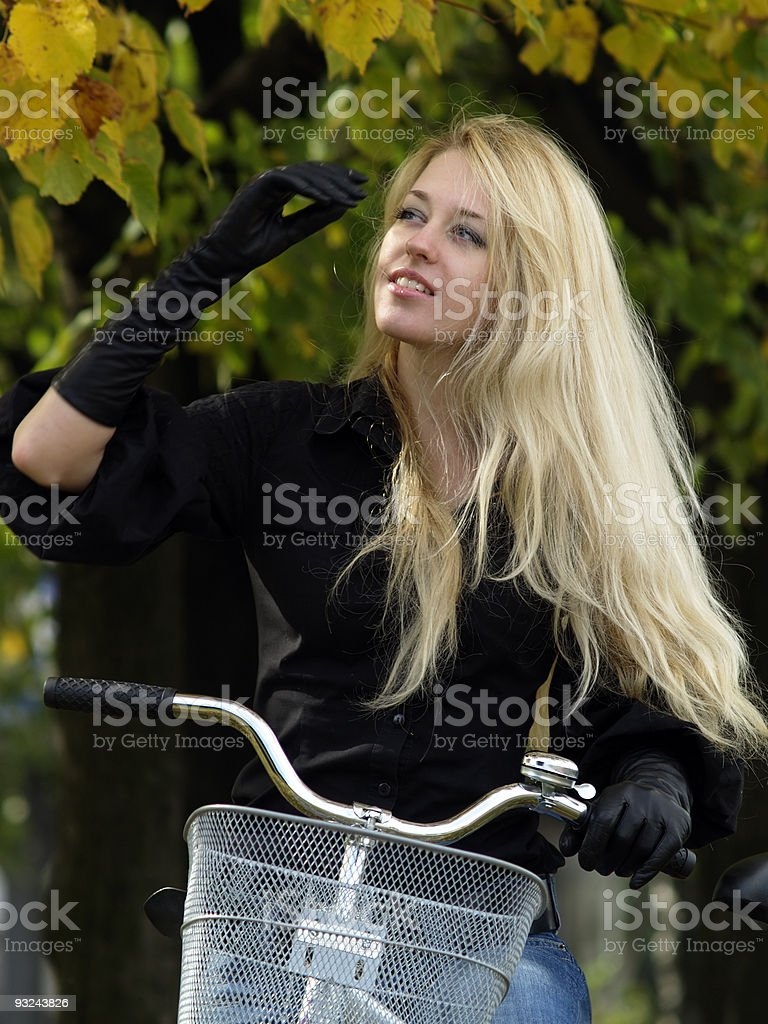 Young woman on bicylce royalty-free stock photo