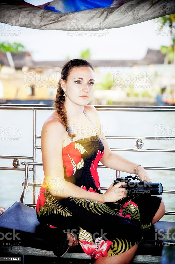 young woman on boattrip in India stock photo