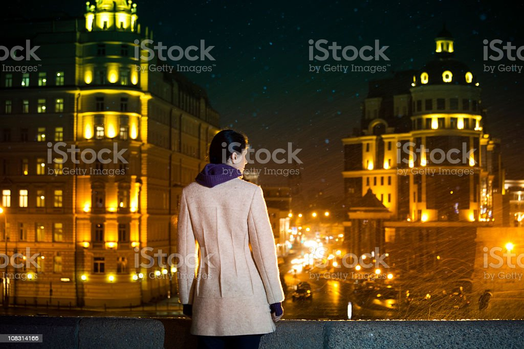 Young woman on bridge at snowy night royalty-free stock photo