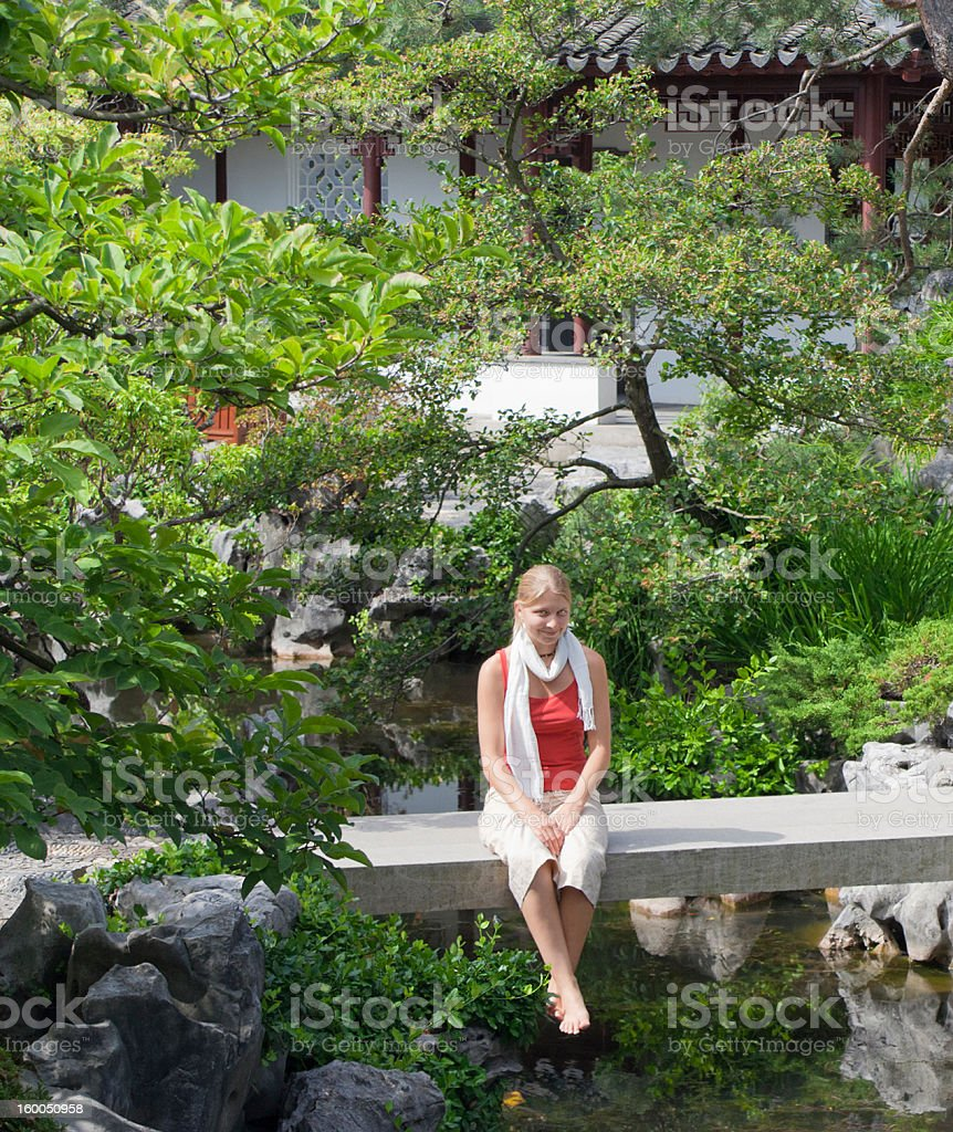 Young Woman on Bridge in Chinese Garden stock photo