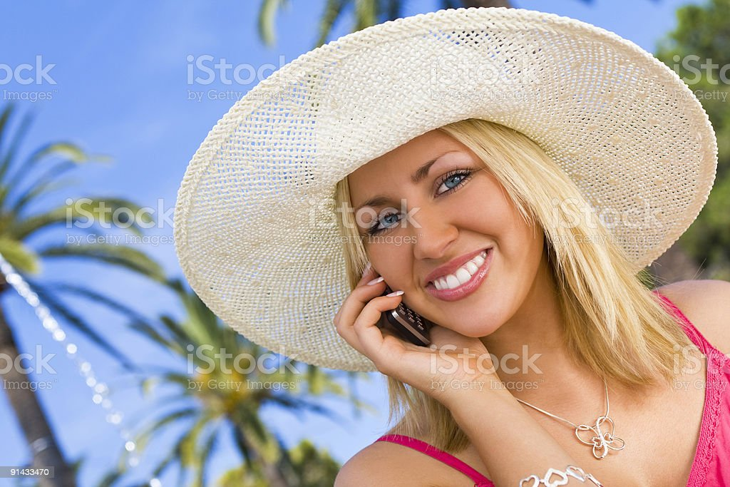 Young Woman on Cell Phone With Tropical Palm Trees royalty-free stock photo
