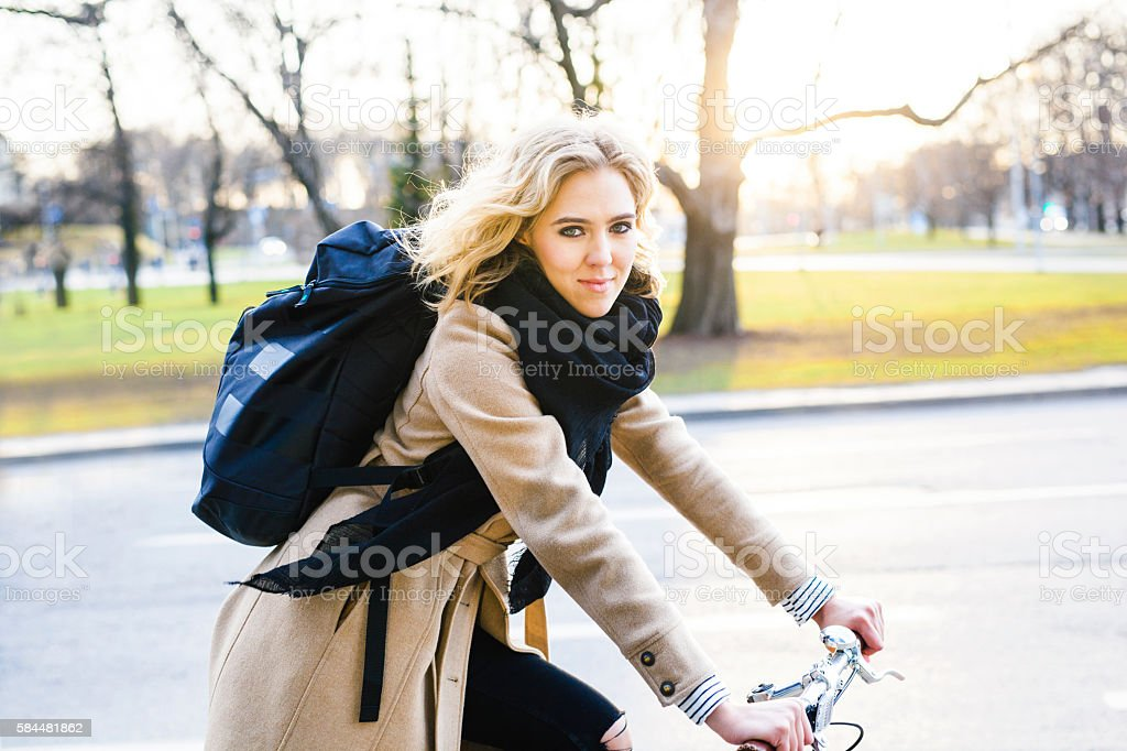 Young Woman On Commute With Bicycle In The Evening stock photo