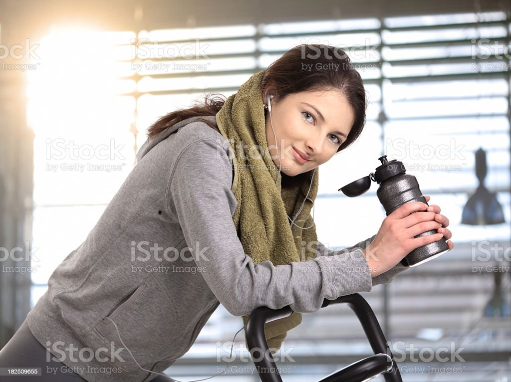 Young woman on exercise machine royalty-free stock photo