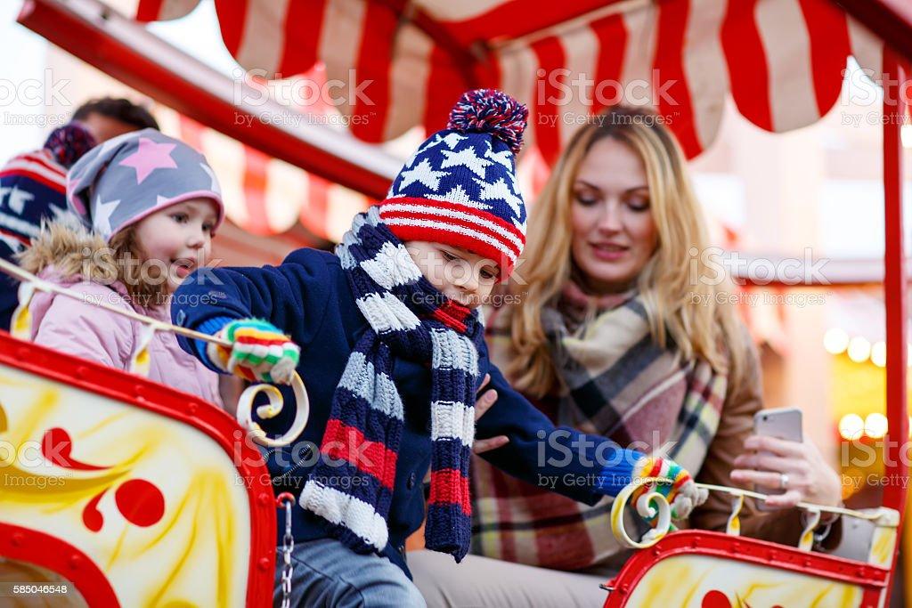 Young woman on ferris wheel on christmas market stock photo
