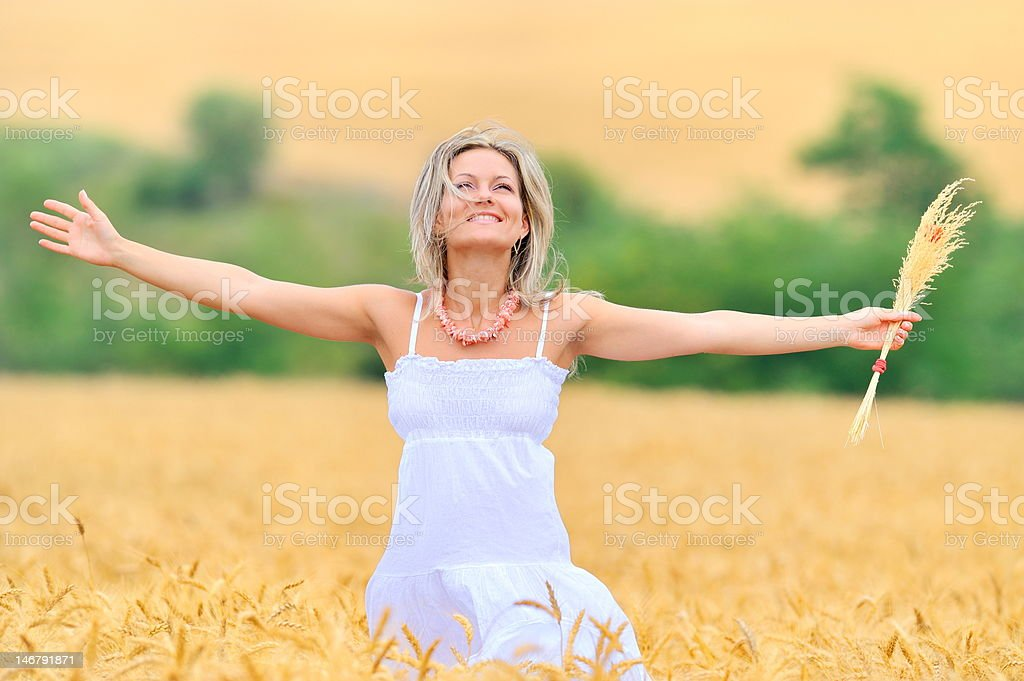 young woman on field in summer royalty-free stock photo