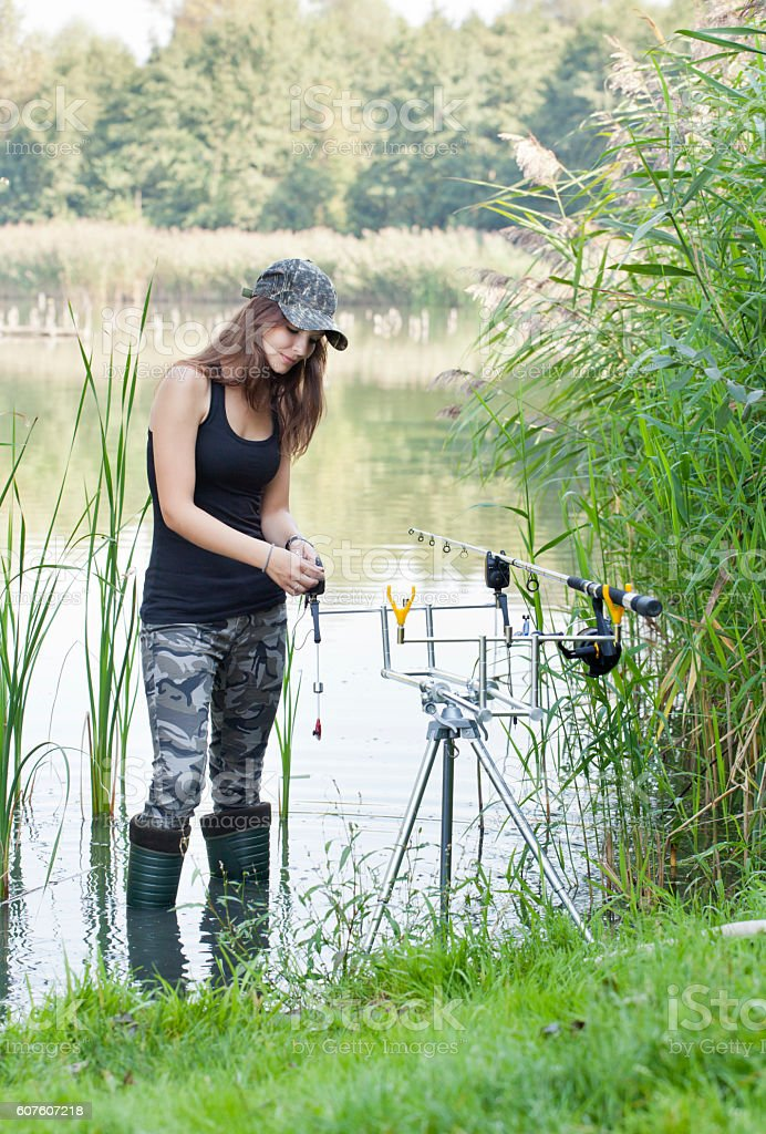 Young woman on fishing stock photo