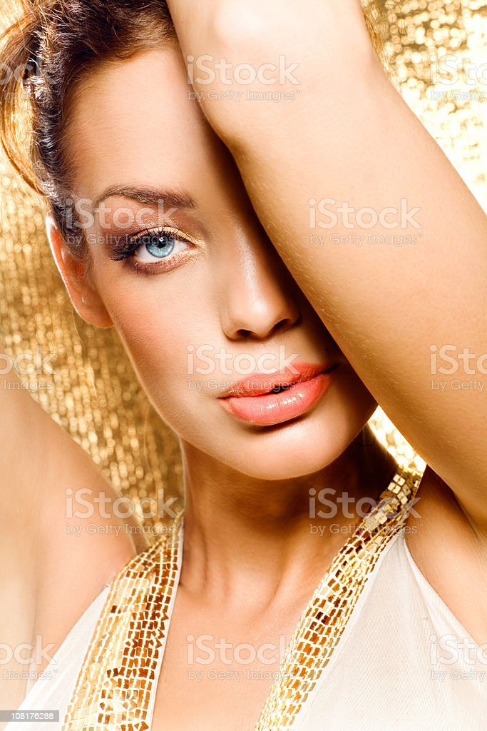 Young Woman on Gold Background royalty-free stock photo