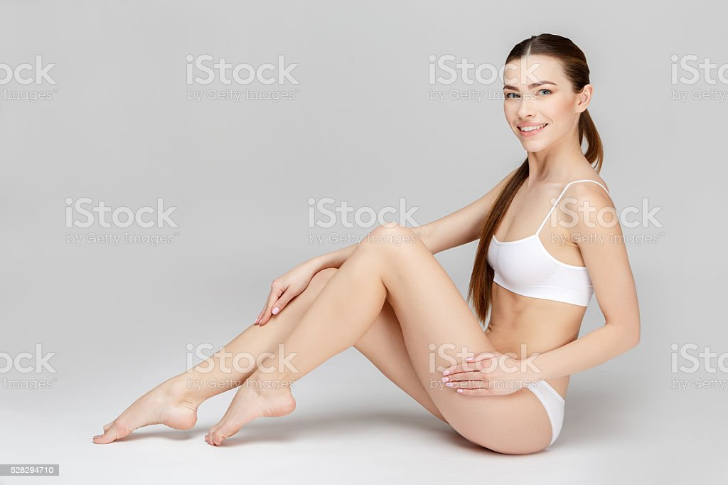 Young woman on gray background stock photo