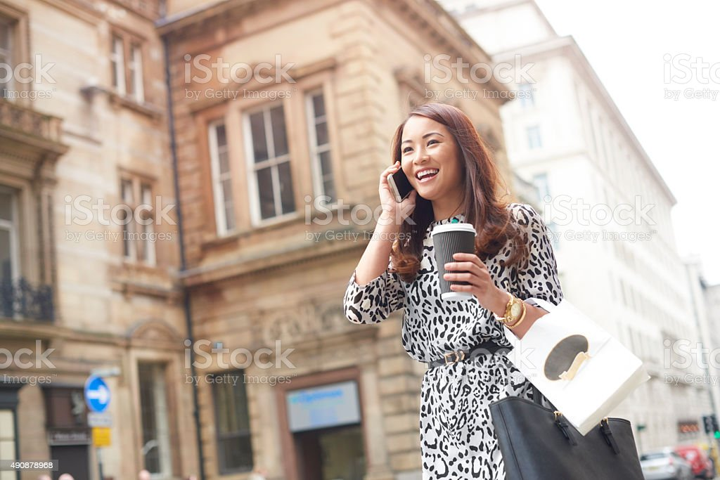 young woman on her lunch break in the business district stock photo