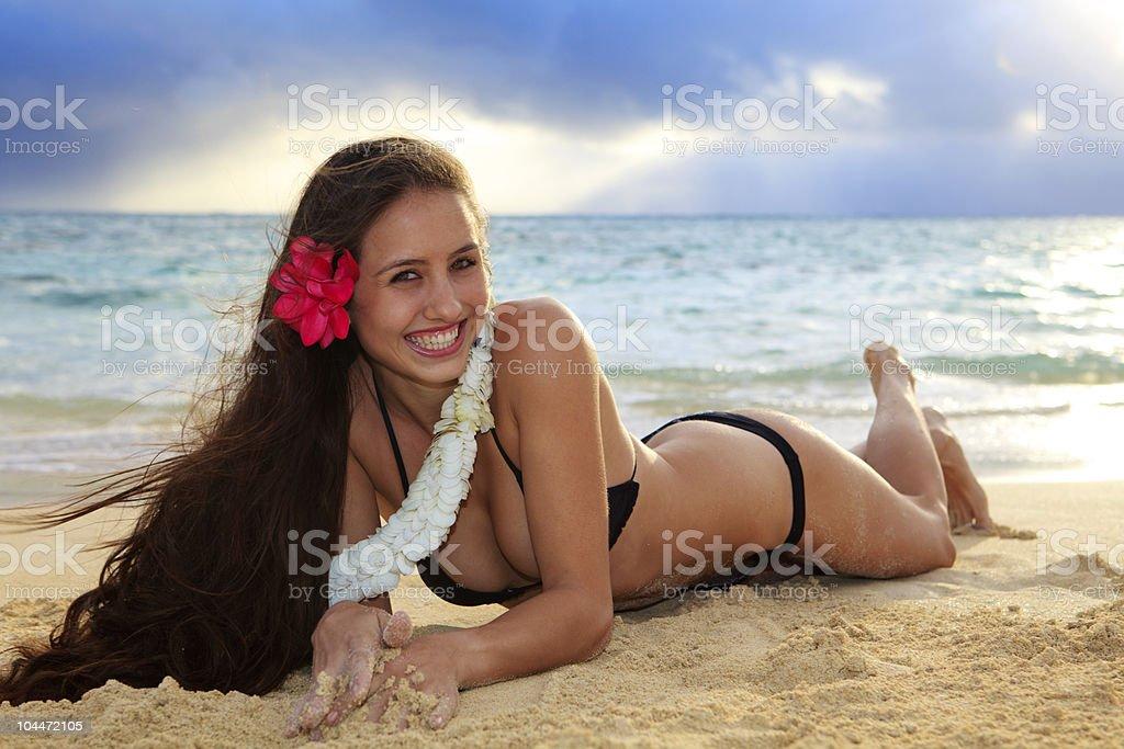 young woman on lanikai beach at sunrise royalty-free stock photo