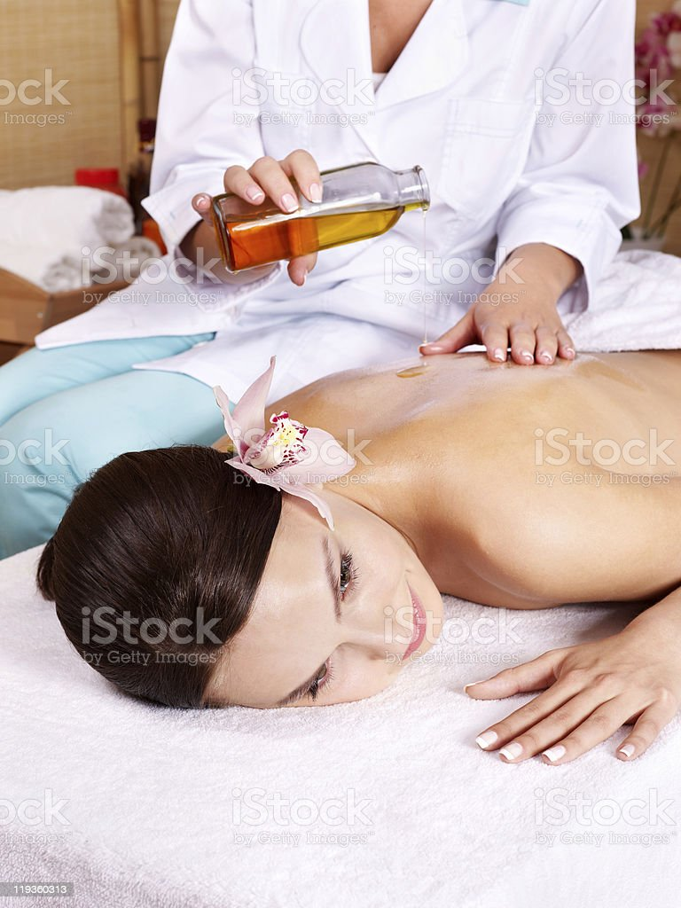 Young woman on massage table in beauty spa. royalty-free stock photo